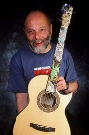 "William ""Grit"" Laskin with guitar"